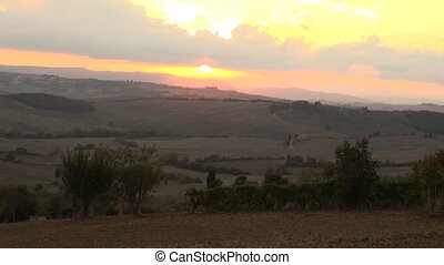 Tuscany sunset - The sun sets over the Val d'Orcia in...
