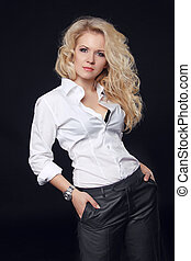 Woman model posing in white shirt with curly long hair style...