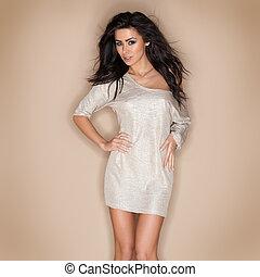Stylish beautiful woman in a miniskirt