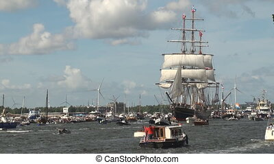 Tall ship on its way to the harbour of Amsterdam