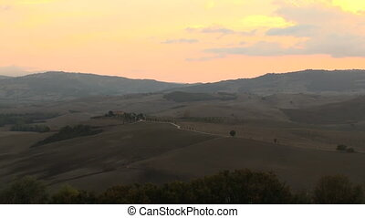 Sunset Tuscany pan - The sun sets over the Val d'Orcia in...