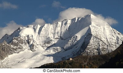 Snow capped mountain peak - Snow capped mountain top in the...