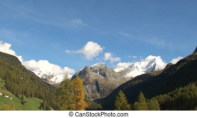 Snow capped mountain top in the alps surrounding the town of...
