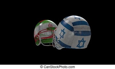 two Football helmets collide - two Football helmets with...