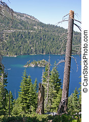Lake Tahoe and Fannette Island - View through the trees of...