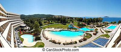 Panorama of the luxury hotel with swimming pool and beach,...