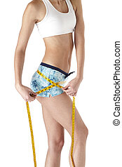 cropped image of a young woman measuring her hips - Cropped...