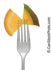 fork with slice fruits - Close-up image of a stainless fork...
