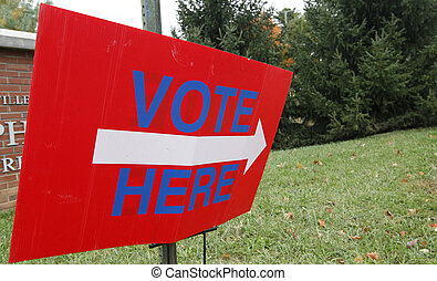 Vote Here - A vote here sign outside a voting station.