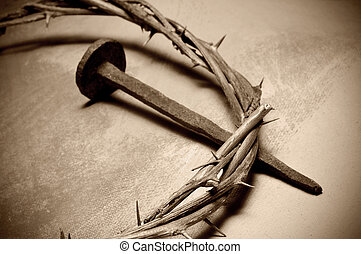 Jesus Christ crown of thorns and nail - closeup of a...