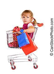 Little girl tired of shopping - Little girl in shopping cart...