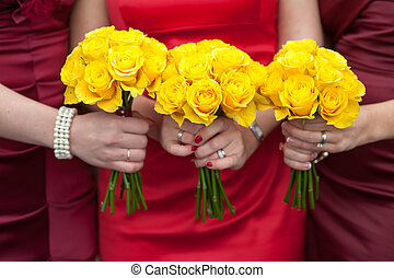 yellow rose wedding bouquets - three bridesmaids holding...
