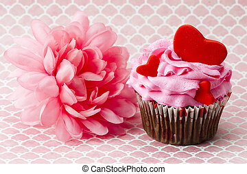 Close-up image of strawberry cupcake with heart shapes on it...