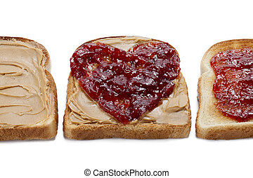close up of bread toast with peanut butter spread and jam -...