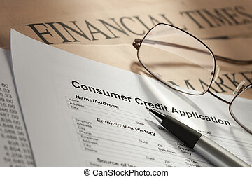 View of consumer credit application form with pen spectacles...