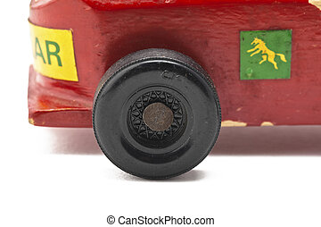 cropped image of tires of a red toy car