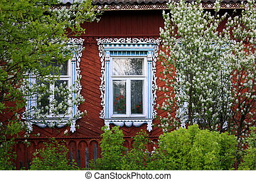 Spring in the street - Carved platbands of the old rural...
