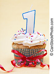 cupcake with number one candle and ribbon