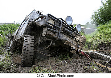 car in trouble - an offroad car in trouble
