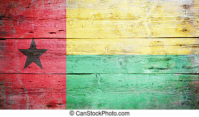 Flag of Guinea-Bissau painted on grungy wood plank...