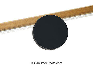 hockey puck and stick - Hockey puck and stick in a...