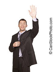 hand up - smiling handsome businessman in coat hand up on...