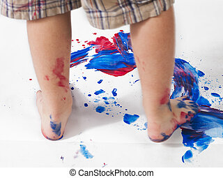 image of a childs foot making footprint on piece of paper -...