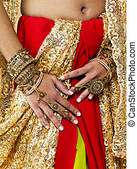 mid section image of a indian bride - Close-up mid section...