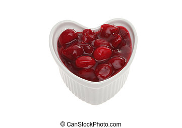 Cranberry sauce made with whole berries in a heart shaped...