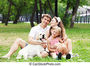 Happy family having fun outdoors - Young Family Outdoors in...