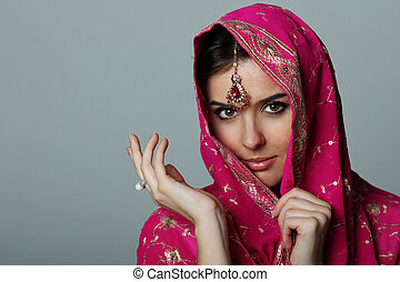 Young beautiful woman in sari