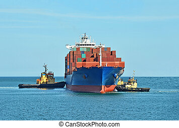 Tugboat assisting container ship - Tugboat assisting...