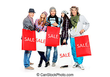 group of shoppers - Group of cheerful young people with...