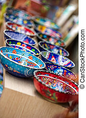 Small colorful pottery bowls in a row - Small beautiful...