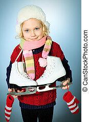 winter sports - Portrait of a cute little girl in warm hat...