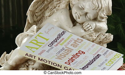 Sleeping angel and book of art Art concept
