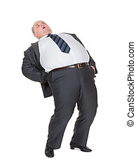 Overweight man with back pain - Very overweight man in a...