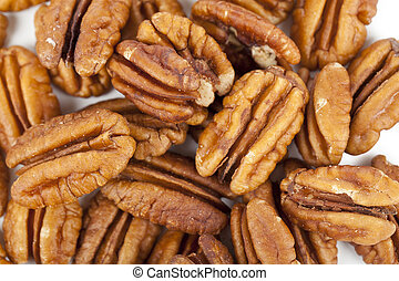 pile of pecan nuts close up - Close up image of pile of...