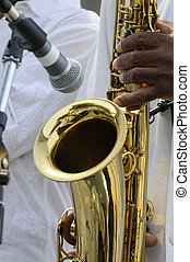 saxophonist playing in live concert
