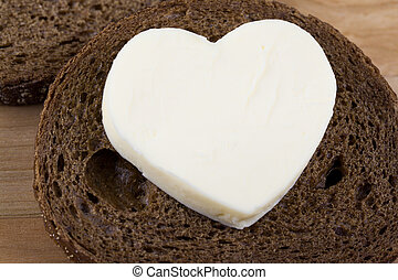 slice of bread with heart shaped butter