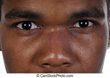 Closeup of African american mans eyes-the look of Mohamed...