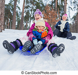 Funny family is sledging in winter-landscape - Two kids with...