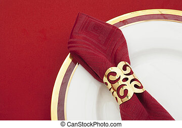 close up image of red table napkin on a plate - Close up...