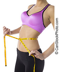 measuring tape in waist of a lady