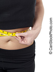measuring the waist line of a woman