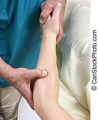 Woman having arm massage from masseur