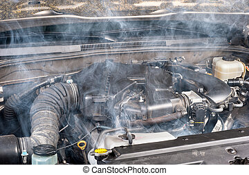 Car engine - A smokey car engine shows signs of a lack of...