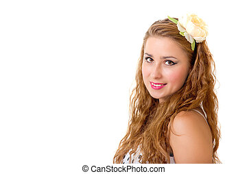 Pretty pin up girl with flower in her long curly hair