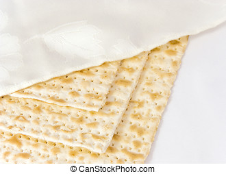 3 covered Passover matzahs - Three square matzahs under a...