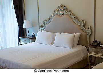 Double bed in the hotel room - room at the luxurious double...